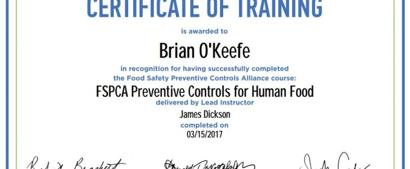 Brian O'Keefe receives food safety certificate at Dan and